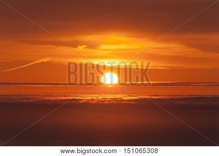 Atlantic Canada orange ocean sunset with clouds.