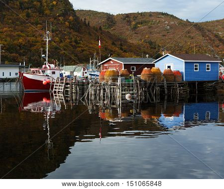 Atlantic Canada fishing boats and stages with reflection.