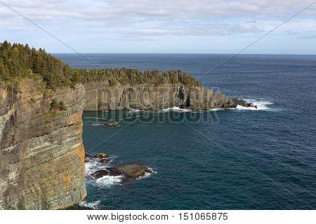 East coast walking trail with rocky Newfoundland coastline.