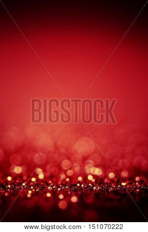 Abstract Red background with defocused sparkle lights. Red Bokeh as Christmas Festive Holiday Background