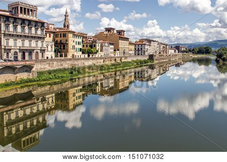 Building Reflections in the Fiume Arno Florence Italy.