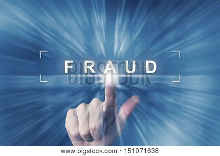 hand clicking on fraud button with zoom effect background