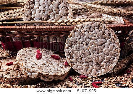 Puffed wheat cake near the breadbox. wheat and goji berries