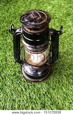 Hurricane lamp storm lantern isolated on grass