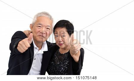 Asian Senior Couple In Business Attire Showing Hand Gesture Thumb Up