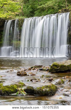 Ddwl Uchaf waterfall (Upper Gushing Fall) on the Nedd Fechan along the Elidir trail in South Wales UK