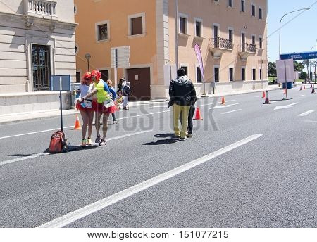 PALMA DE MALLORCA BALEARIC ISLANDS SPAIN - APRIL 10 2016: Performers and audience at the Women's marathon in Palma de Mallorca Balearic islands Spain on April 10 2016.