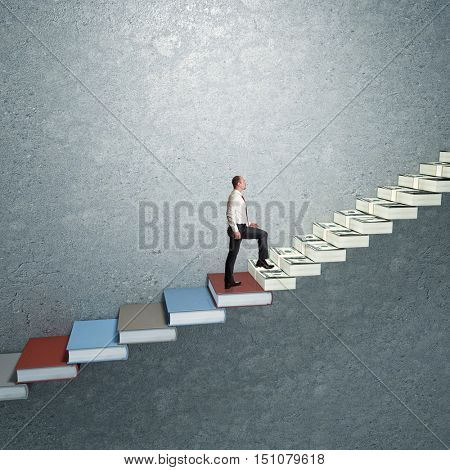 man go up on money and book stair