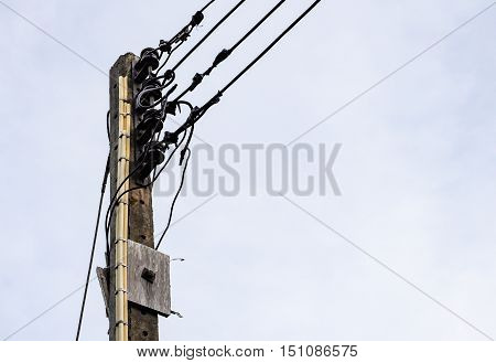 Old electric pole for use in the rural village of Thailand.