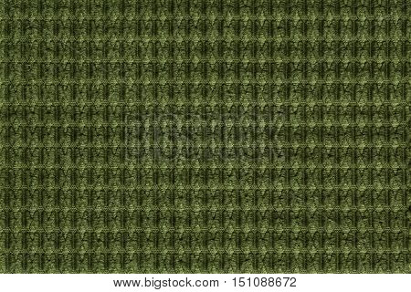 Dark green background from soft fleecy fabric close up. Texture of textiles macro.