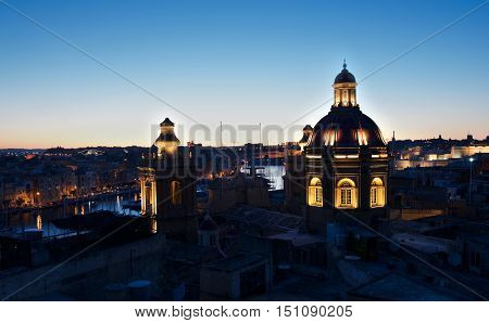 Birgu church on night time with nice colorful illumination, Birgu, Malta, night light, maltese city on the night, catholic church in Malta in dark background