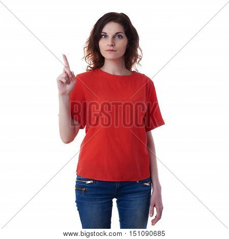 Smiling young woman in casual clothes over white isolated background pointing, showing direction or pushing button, happy people concept