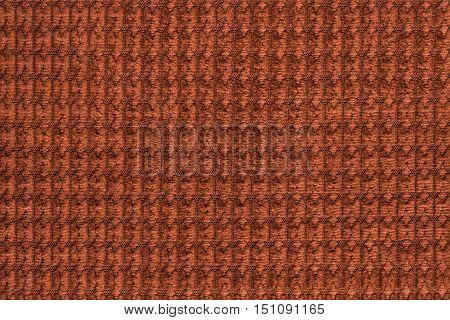 Dark orange background from soft fleecy fabric close up. Texture of textiles macro.