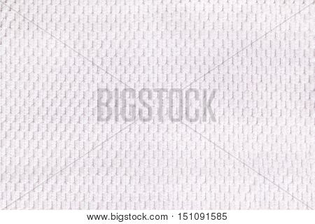 White background from soft fleecy fabric closeup. Texture of textile macro.