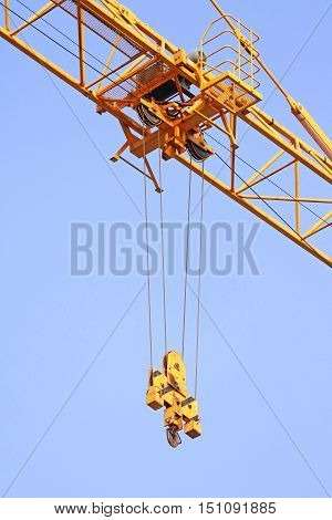 Hoist trolley Mechanism of Tower Crane on clear blue sky background