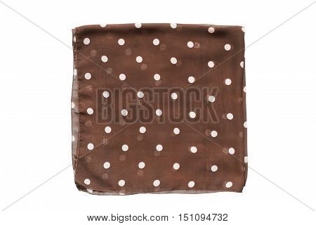 Folded brown polka dots kerchief on white background