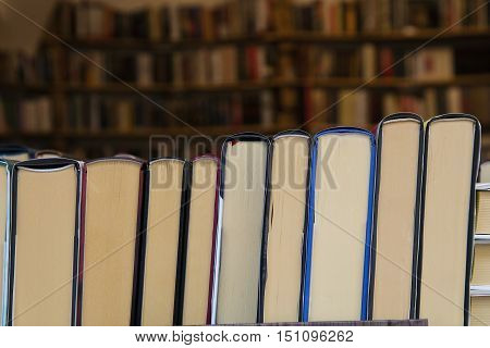 Books Back On Wooden Shelves Of Store Close Up