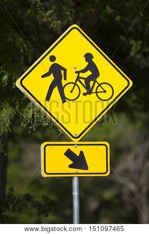 Bicycles and pedestrians yellow road warning sign