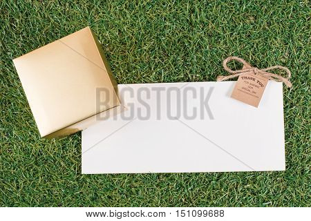 The white letter with tag on the grass ground