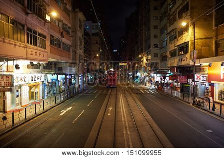 HONG KONG - OCTOBER 25, 2015: view from upper deck of double-decker tramway. The tram is the cheapest mode of public transport on Hong Kong island.