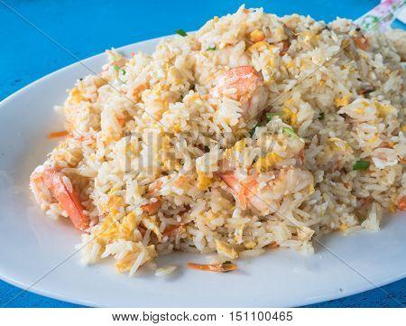 Delicious shrimp fried rice on white dish.
