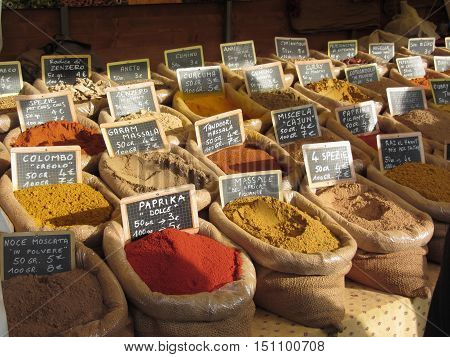 Colorful spices in jute bags at the local market . Tuscany Italy