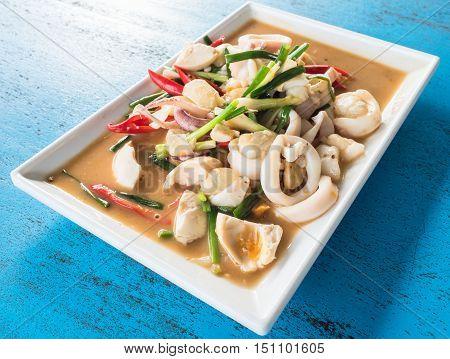Stir fried squid with salted egg yolk.
