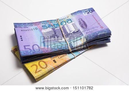 Pile of Samoa Tala bank notes isolated on white
