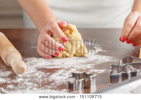 Woman hands Cooking shortcrust pastry on table