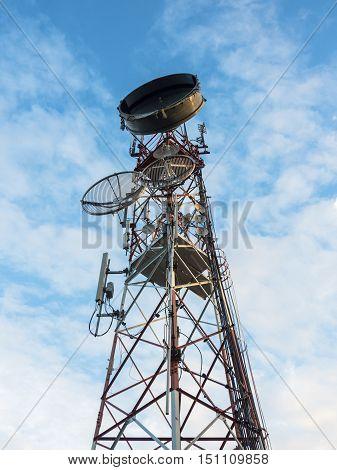 Telecommunication mast TV antennas wireless technology with blue sky.