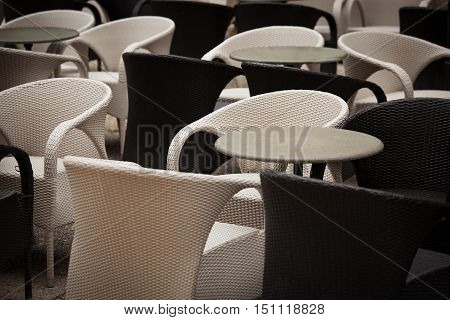 Blank black and white tables and chairs in the restaurant