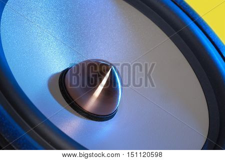 picture of a blue illuminated loudspeaker detail