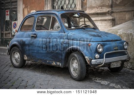 Rome Italy - May 4 2014: Fiat 500 parked in Rome on May 4 2014. The Fiat 500 was one of the most produced European cars. She has been manufactured over the years in years 1957-1975 - Rome May 4 2014