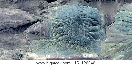 Delusion egg turquoise alien to breaking and seek prey in the African desert, photography deserts of Africa from the air,Munimara Collection of Abstract Naturalism,stone texture with cracks irradiated