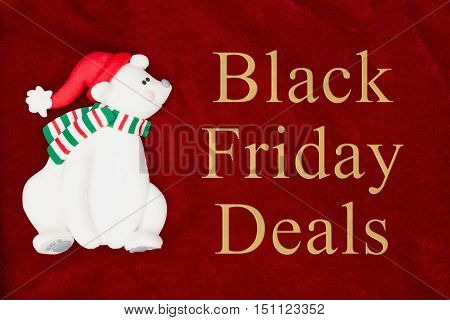 Black Friday Deals message Red plush fabric with a polar bear background with text Black Friday Deals