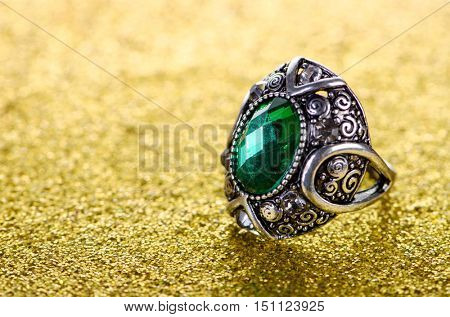 Jewellery concept with ring on shiny background