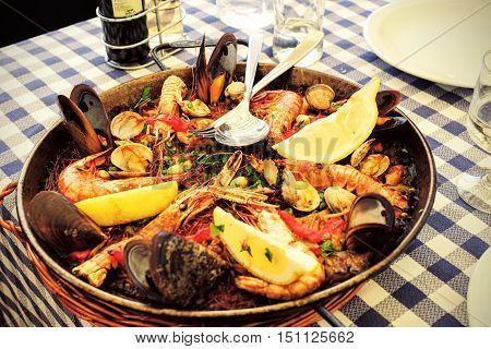 Traditional Home made Spanish Fideua, a noodle Paella with seafood