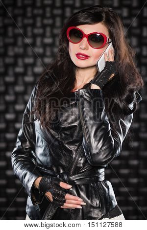 Attractive Woman In Black Leather Jacket