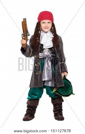 Young Boy Posing With A Gun