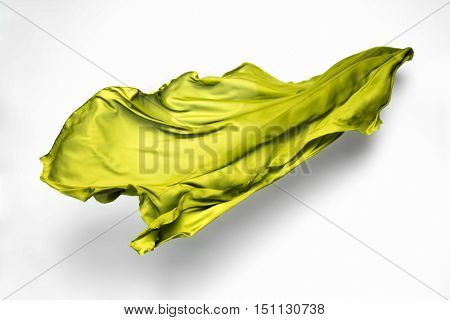 abstract piece of green fabric flying, high-speed studio shot