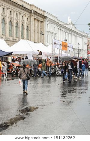 St. Petersburg, Russia - 12 August, People under umbrellas on a holiday,12 August, 2016. The annual International Festival of Motor Harley Davidson in St. Petersburg Ostrovsky Square.