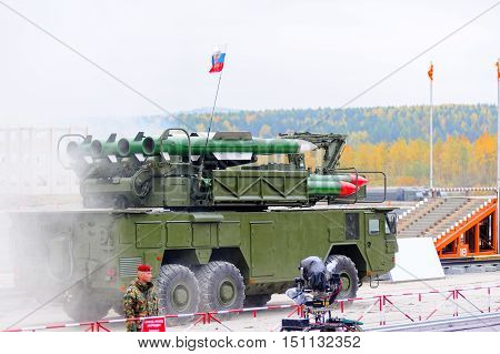 Nizhniy Tagil, Russia - September 26. 2013: Bouck M2 complex placed on wheel drive truck MZKT-69221 Medium-range surface-to-air missile systems on demonstration range. Russia Arms Expo-2013
