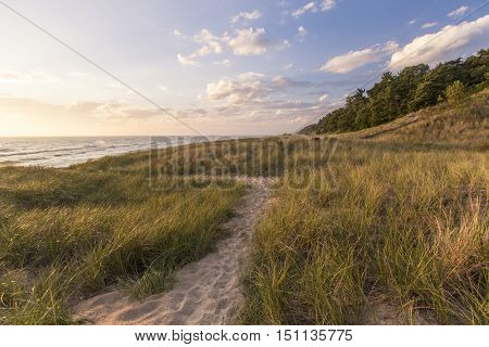 Summer Vacation At The Beach. Winding path through dune grass and sand dunes on the shores of Lake Michigan. Hoffmaster State Park, Michigan