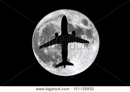 The full Moon is seen isolated on a black background. High contrast high resolution image taken with a full frame dslr camera. Aairplane silhouette passing in front of the moon.