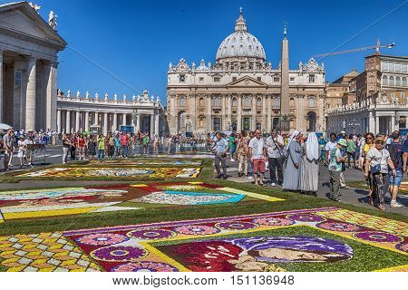 Rome Italy - June 29 2014: On the occasion of the patron saints of the city of Rome St. Paul and St. Peter was held in Piazza Pio XII and in the Via della Conciliazione Traditional Flower Festival. Some tourists admire the floral decoration