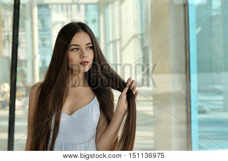 Beautiful Girl Holding Her Hair On A Bent Arm