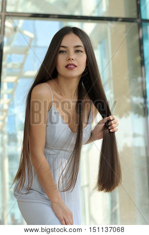 Attractive Girl Clutched Her Hair In A Fist