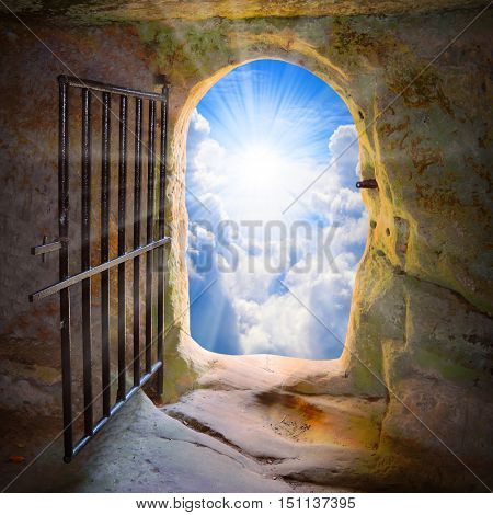 Way to freedom or to heaven. Opened door from prison or grave. Hope metaphor. poster
