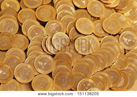 Group of gold coins in heap business money