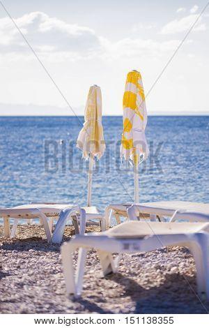 Parasols and chairs on beach; Zlatni rat, Bol, island of Brac